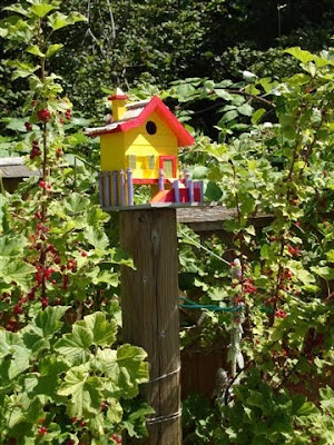 Brightly colored birdhouse