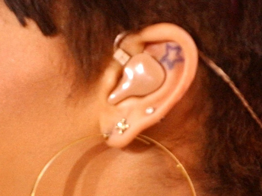 rihanna star tattoos. Rihanna Star Tattoo Ear