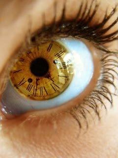 romantic eye inside clock wallpaper
