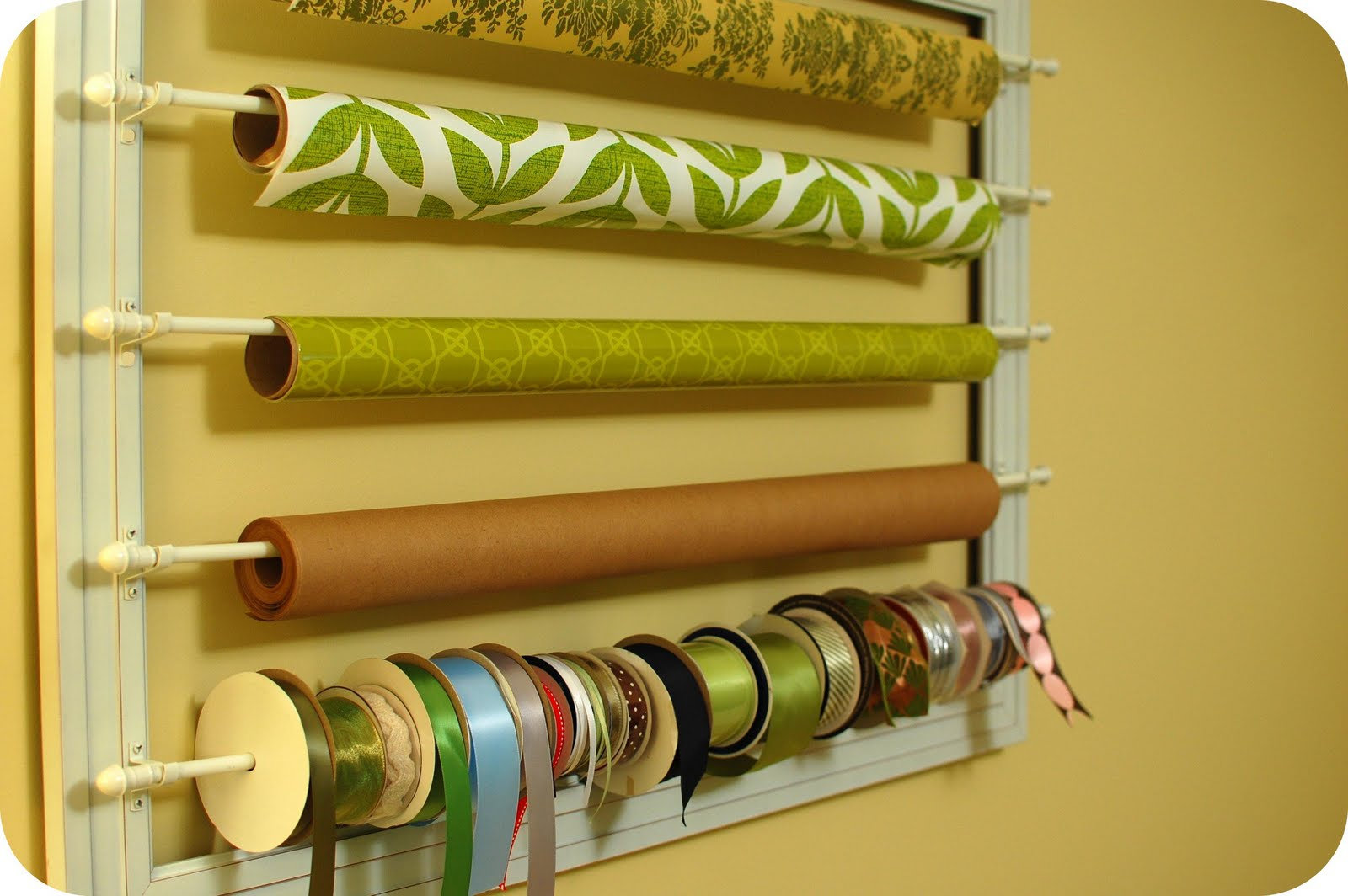 wrapping paper rack Blogger jen jones shares her tips for creating a high-impact wall with patterned wrapping paper this $3 wallpaper hack is the stuff of diy dreams sean.