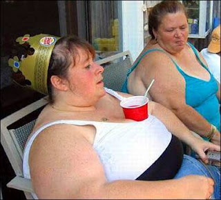 fat-chick-drinking-from-tits-thumb.jpg
