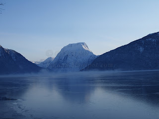 Frozen lake, mountains and fog
