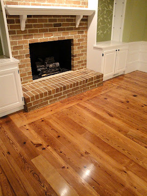 Installing the antique heart pine flooring pretty handy girl for Wood floor up to fireplace