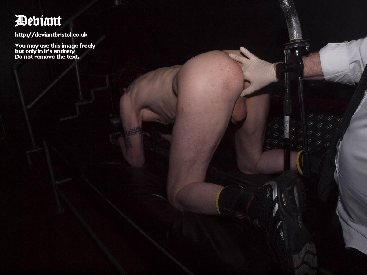 Naked male in public bondage