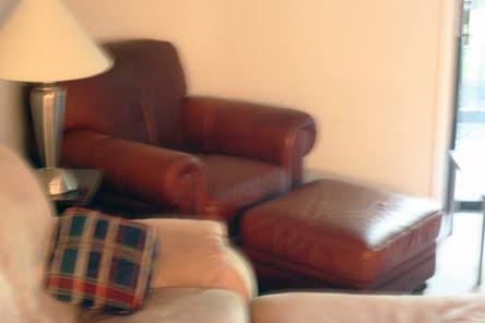 Beau Natuzzi Leather Chair And Ottoman $300 SOLD