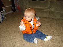 In his orange vest