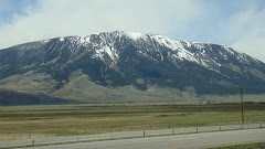 See Snow on Mountains Driving to Deer Lodge, Montana
