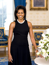 A radiant Michelle Obama poses for her official White House portrait.