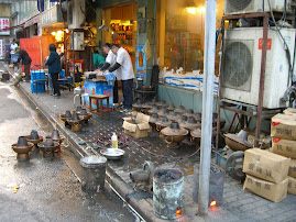Street scene with cooking pots for dinner
