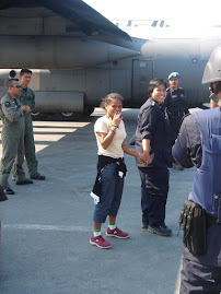 Suzana board TUDM's flight to Malaysia. She was operated on her both ear in Terendak Army Hospital
