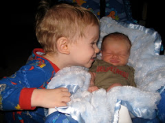 tommy loving on brennan at 2 weeks