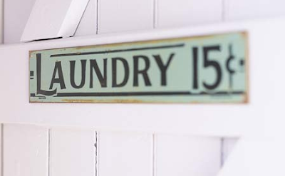 Rusted metal laundry sign by Re