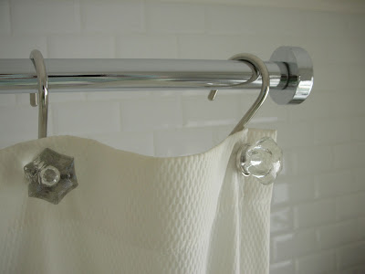 Shower rail from Next and crystal shower curtain hooks from Restoration Hardware