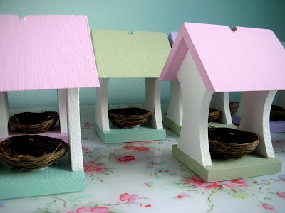 Easter wooden bird feeders with nests