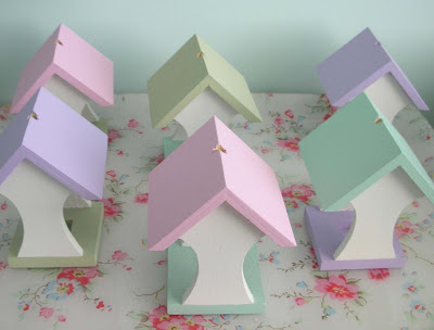 Wooden bird feeders in Easter colours