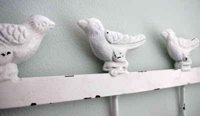 Enchanted bird coat hanger hooks close-up
