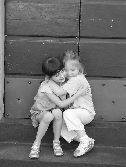 two little girls hugging gif
