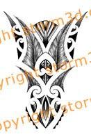 realistic feathers in maori tattoo