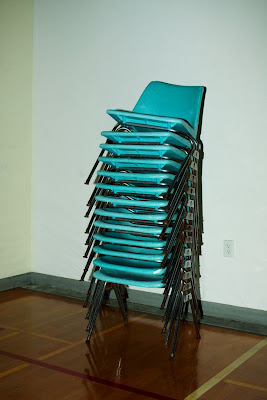 Stack of blue school chairs