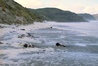 Knee to waist-deep foam on South Cape Bay, mid 2005, following storm