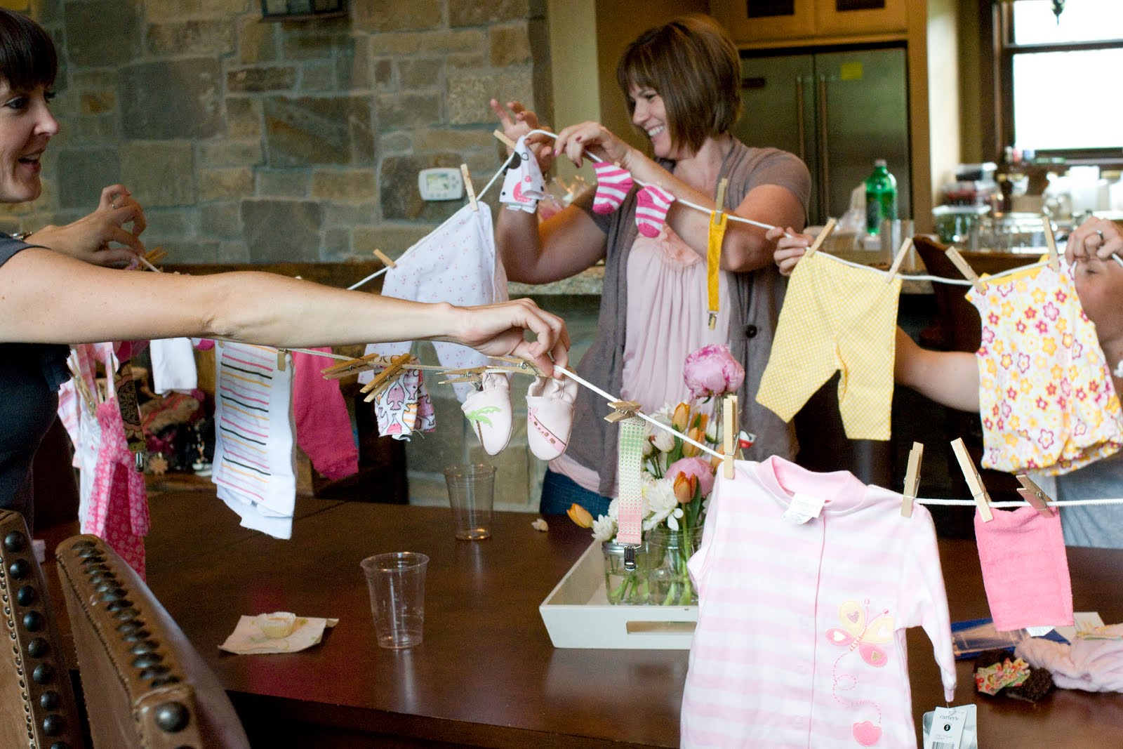 The cutest baby shower gift ideas the polkadot chair for Baby shower clothesline decoration