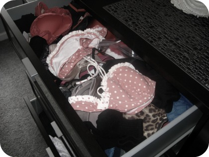 messy drawers before photo bras bathing suits