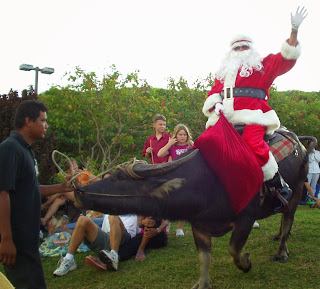 Santa arriving on a carabao