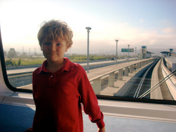 Shane at SFO on airtram, July 9, 2010