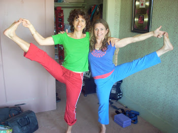 Cara and Rebecca in Hastapadangustasana