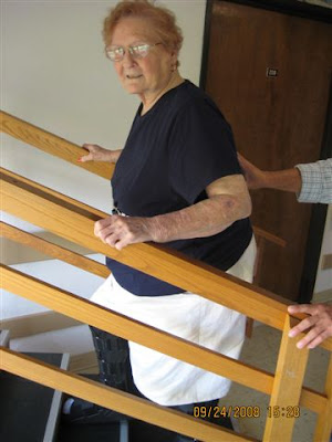 Photo of Lucille climbing practice stairs at rehab.