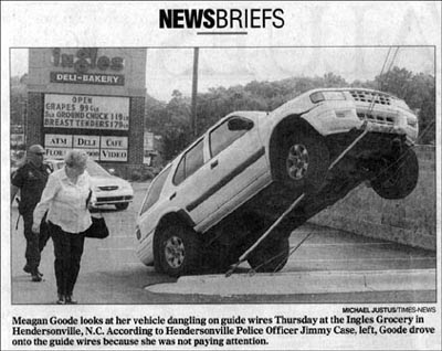 funny news photo of car doing high wire stunt accident by woman in north carolina because she wasnt paying attention
