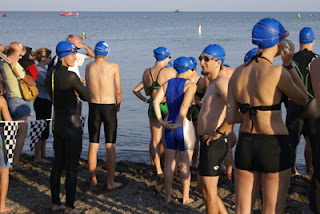 I'm in the blue-and-silver knee-length tri-suit, arms stretching behind me. We're waiting to get kicking.