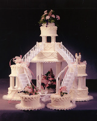 wedding cake with flower and stairs photo