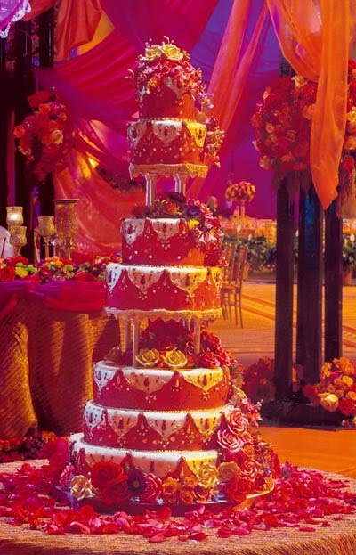 Indian Wedding Cake Decorated With Mahndi And Elephants Topper