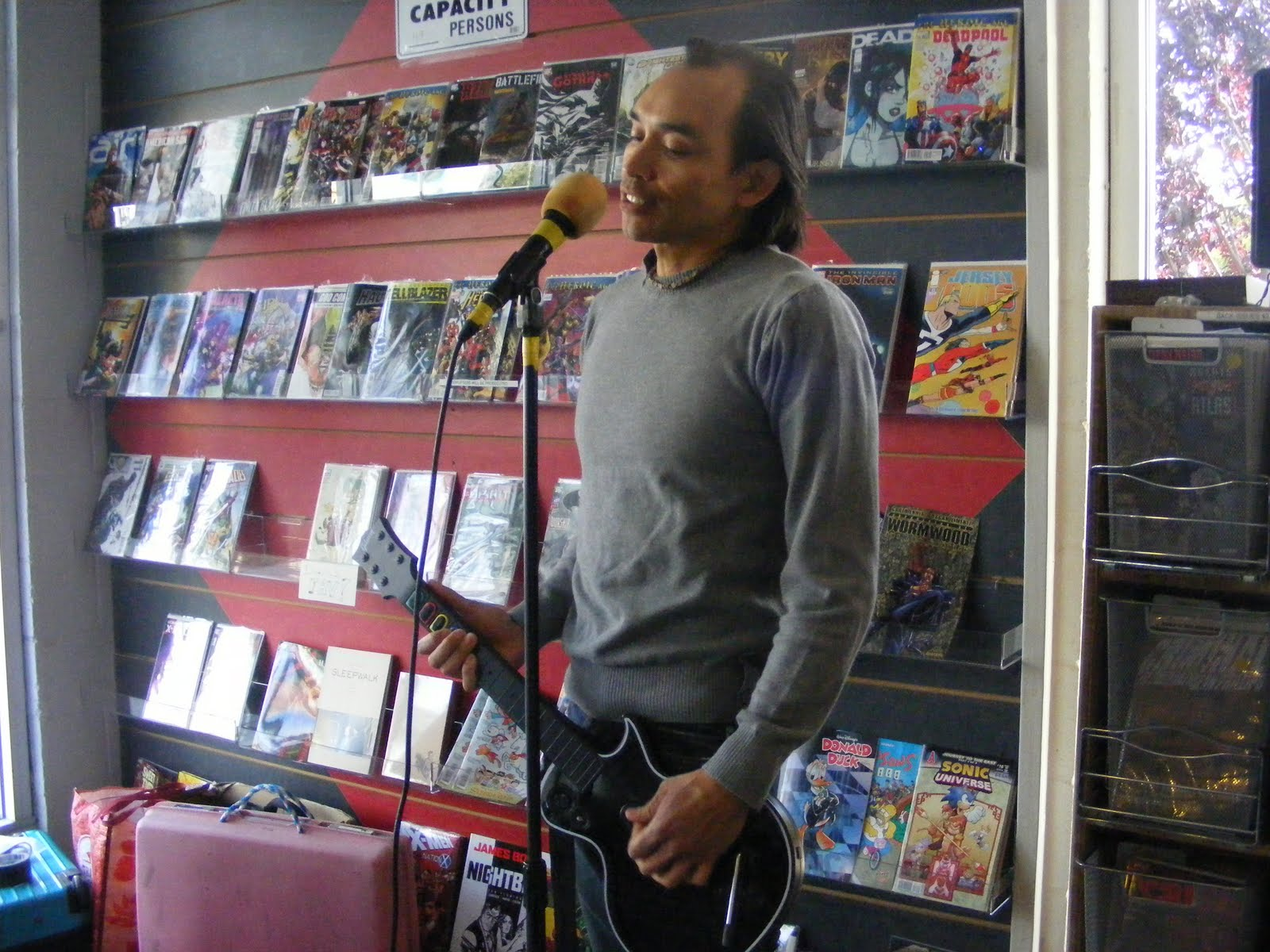 Singing karaoke in a comic book coffee shop