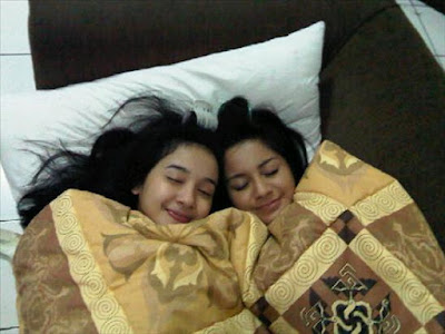 Bella and Kirana are sleeping on couch