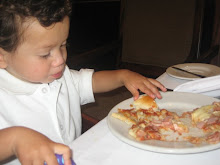 Eating his pizza