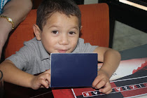 Mateo looking at his NEW Visa!!!!! He can leave the country now & come home to Kansas!!