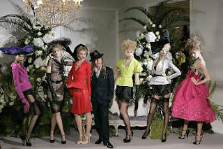 John Galliano poses for the finale of Christian Dior haute couture show alongside models @ the fashion escapist