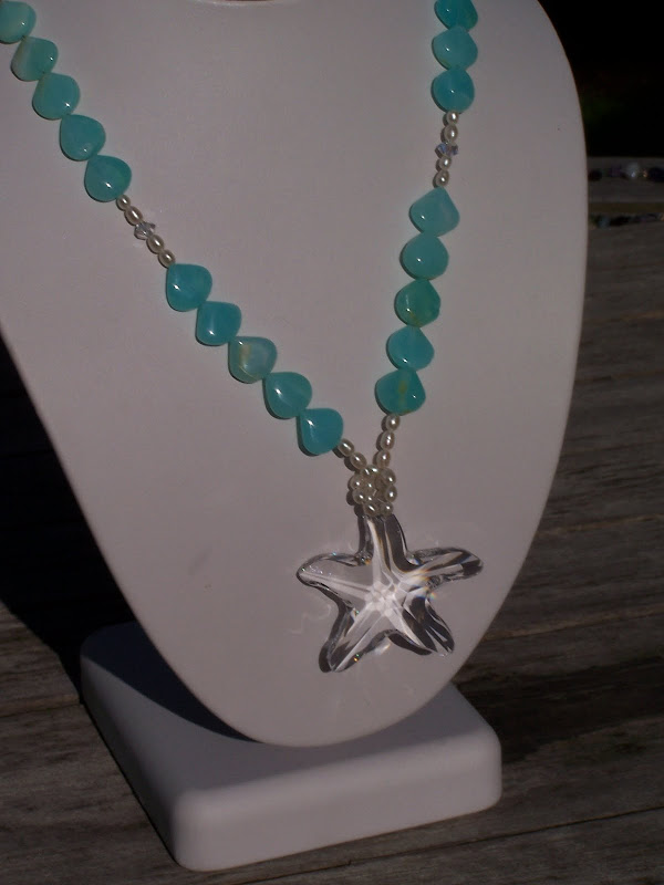 Be a Sea Goddess with this necklace of dyed blue Opal, tiny pearls and  title=