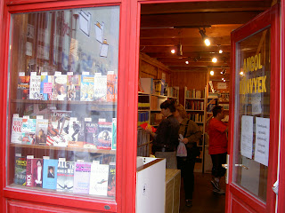 red bus bookstore window