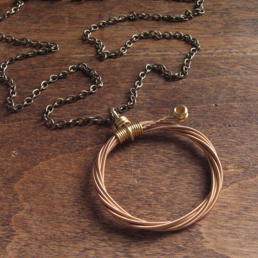 Recycled guitar string jewelry - Plucking Pendants Creates Amazing Recycled Guitar String Jewelry When