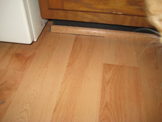 This is to the right of my stove, if you look close you can see a gap between the floor and the trim - or you can click to enlarge the picture