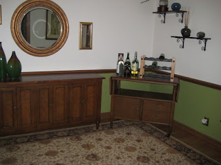 corner of the dining room - see the blue pot they broke up on that second shelf?