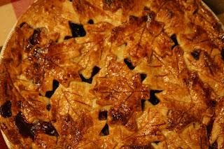apple blackberry pie with pate brisee crust cut in the shape of fall ...