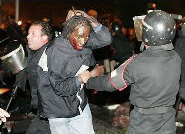 Sudanese_women_beaten_by_Egyptian_police.jpg
