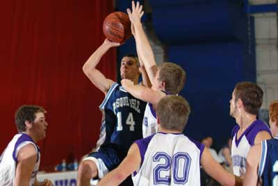Ackerman scores 18, Wildcats breeze past John Bapst 62-29