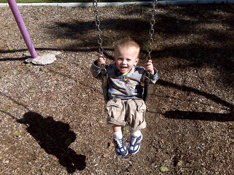 Kade loves the swings!