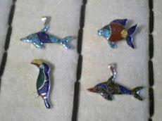 animales  en plata y mosaico