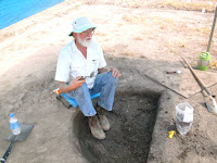 Archaeologist John Connaway excavates a trash pit or midden at the Carson Mound Site